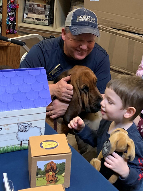Scent Evidence K9 CEO, Paul Coley, and Rex the Rescue Pup teach a new friend how to stay safe from getting lost in the outdoors with a Scent Preservation Kit®